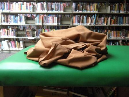brown sheet on a green table cloth