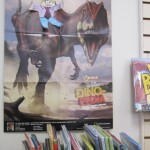 Flat Stanley and on a dinosaur poster