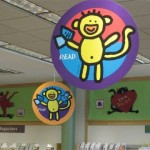 read with a monkey on paper decor hanging from the ceiling