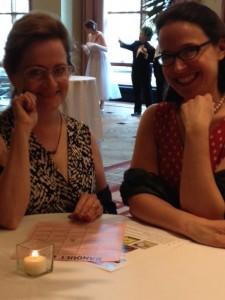 two women read to play bingo