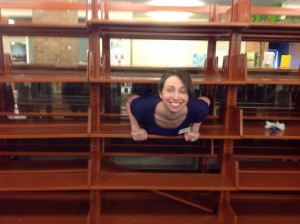 Other Jobs as Needed: Seeing if Kids Can Fit in Empty Shelving During Construction
