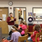 adult reading aloud to kids