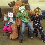 children posing with a moose