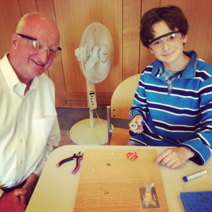 A grandfather and his grandson working on their skill badge. Photo courtesy of author.