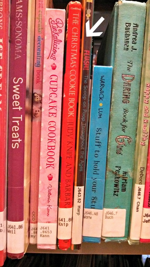 Browsing the DDC 640s: My Christmas Cookie Book and Flush: The Scoop on Poop Throughout the Ages - strange shelf-fellows indeed! (c) L Taylor