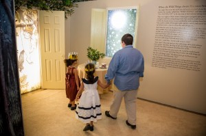 A family explores Max's bedroom come to life. Photo owned by the Enoch Pratt Free Library.