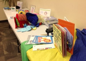The table full of early literacy tools, sorted by staff members. [Image courtesy of the author.]