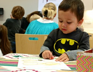A child colors during a Día program at Skokie Public Library (image courtesy of Joanna Ison)