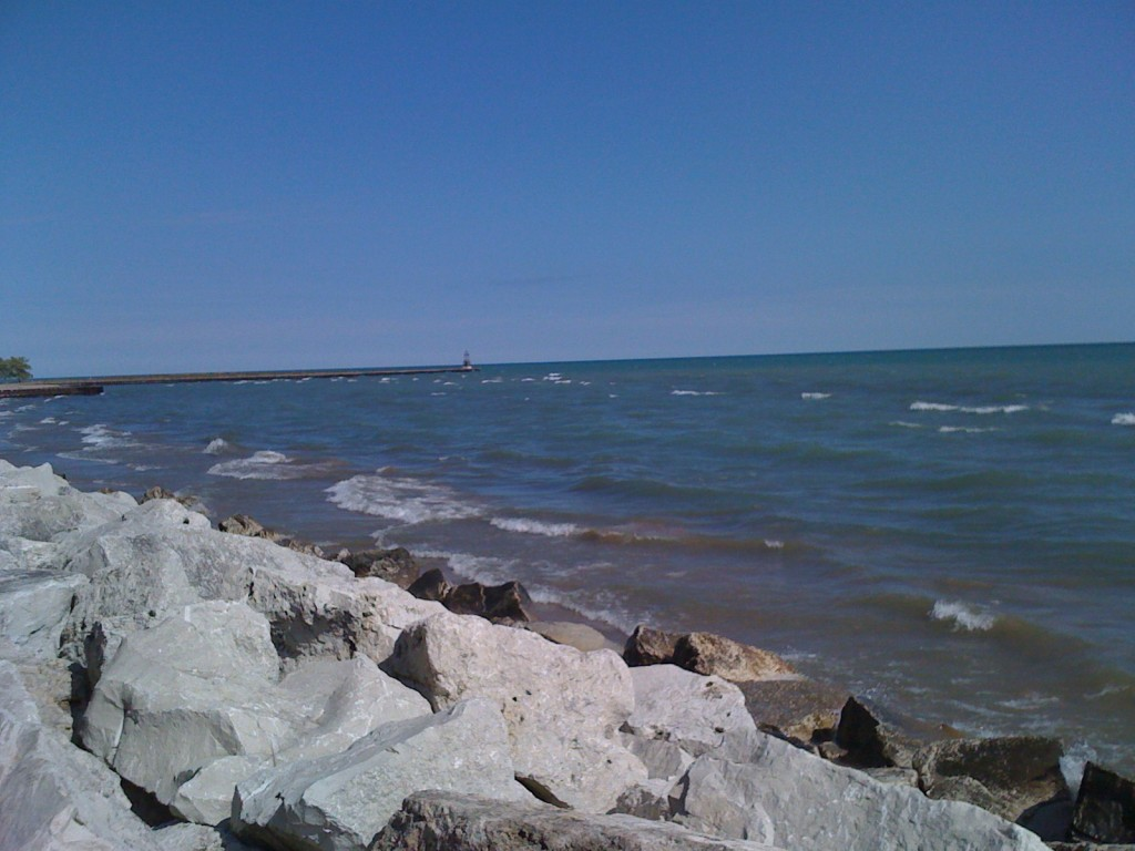 My favorite spot on the Lake Michigan shore by my house to read in the summer. Photo source: Andrew
