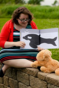 Me, reading to Applesauce, an easier storytime training audience. Photo courtesy of Andrea Sowers.