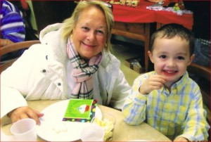 Mary Abel and 4-year-old, grandson, Robby enjoying a snack after story time