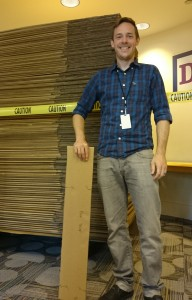 Children's librarian, Warren Shanks, showing off a stack of newly purchased cardboard. Photo credit: Amy Seto Forrester