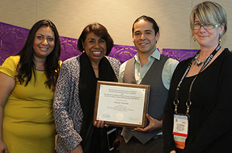 Duncan Tonatiuh accepts a 2015 Belpré honor plaque for Separate Is Never Equal: Sylvia Mendez and Her Family's Fight for Desegregation with (l to r) Silvia Cisneros, 2014-15 REFORMA president, Sylvia Mendez, subject of the Honor Book, and Ellen Riordan, 2014-15 ALSC president. (Photo courtesy of ALSC)