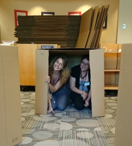 Shelvers Sarah Cosoer and Sallie King take a break from cardboard prep. Photo credit: Amy Seto Forrester