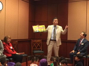 "Congressman Mark Takano of California reads ""Book Fiesta!"" while Pat Mora, me, and kids from CentroNia and Payne Elementary celebrate. (Photo by Aimee Strittmatter)"