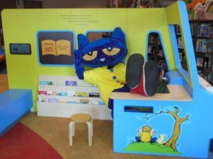 Pete the Cat relaxes in the Bookmobile