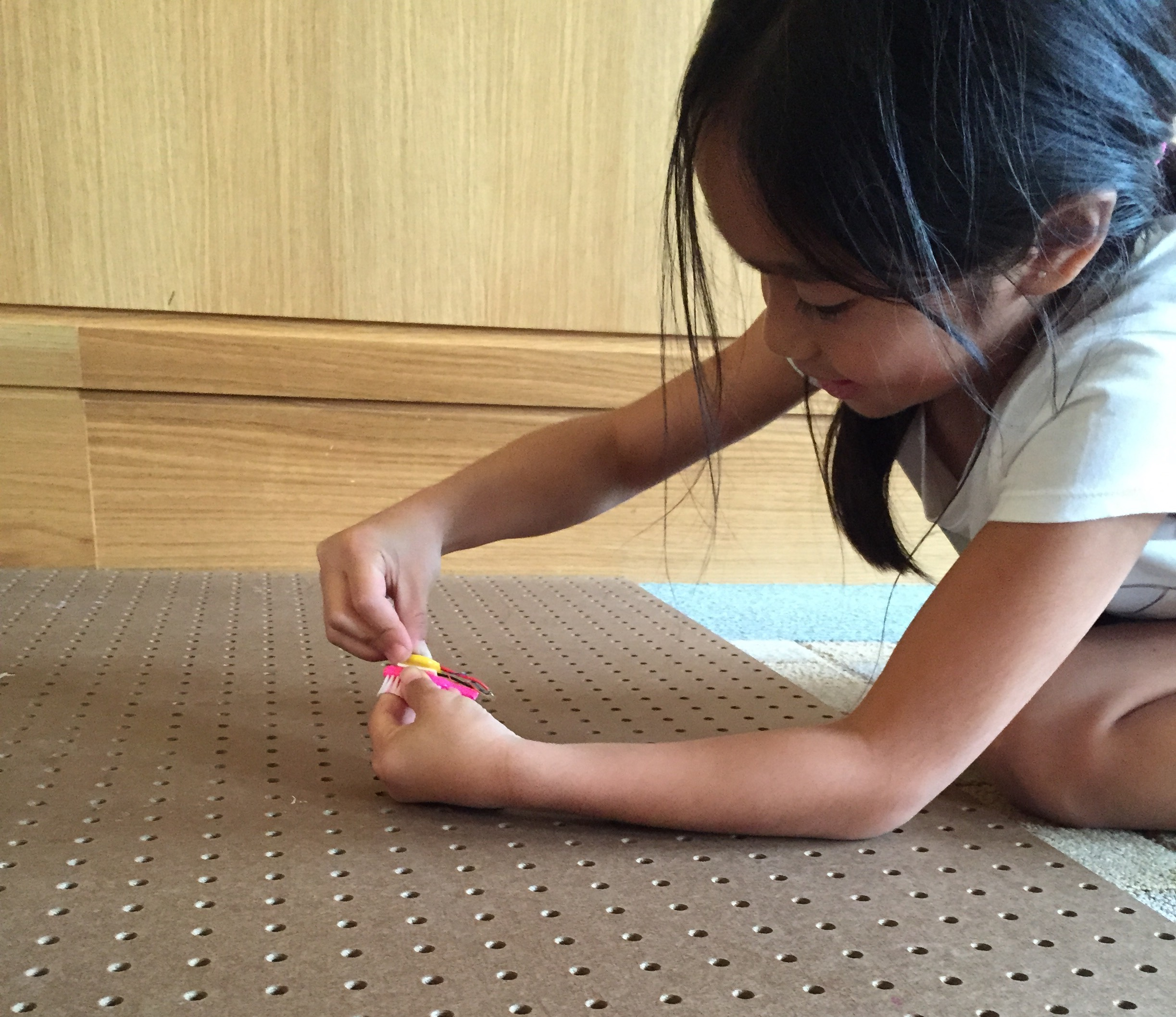 Tiny hands are perfect for assembling Brushbots.