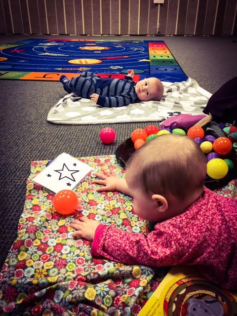 Photo of babies on floor