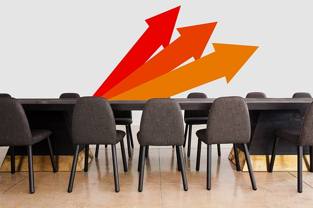 Conference table with arrows symbolizing direction
