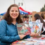 Guest blogger Dr. Martha Bernadett holding children's books
