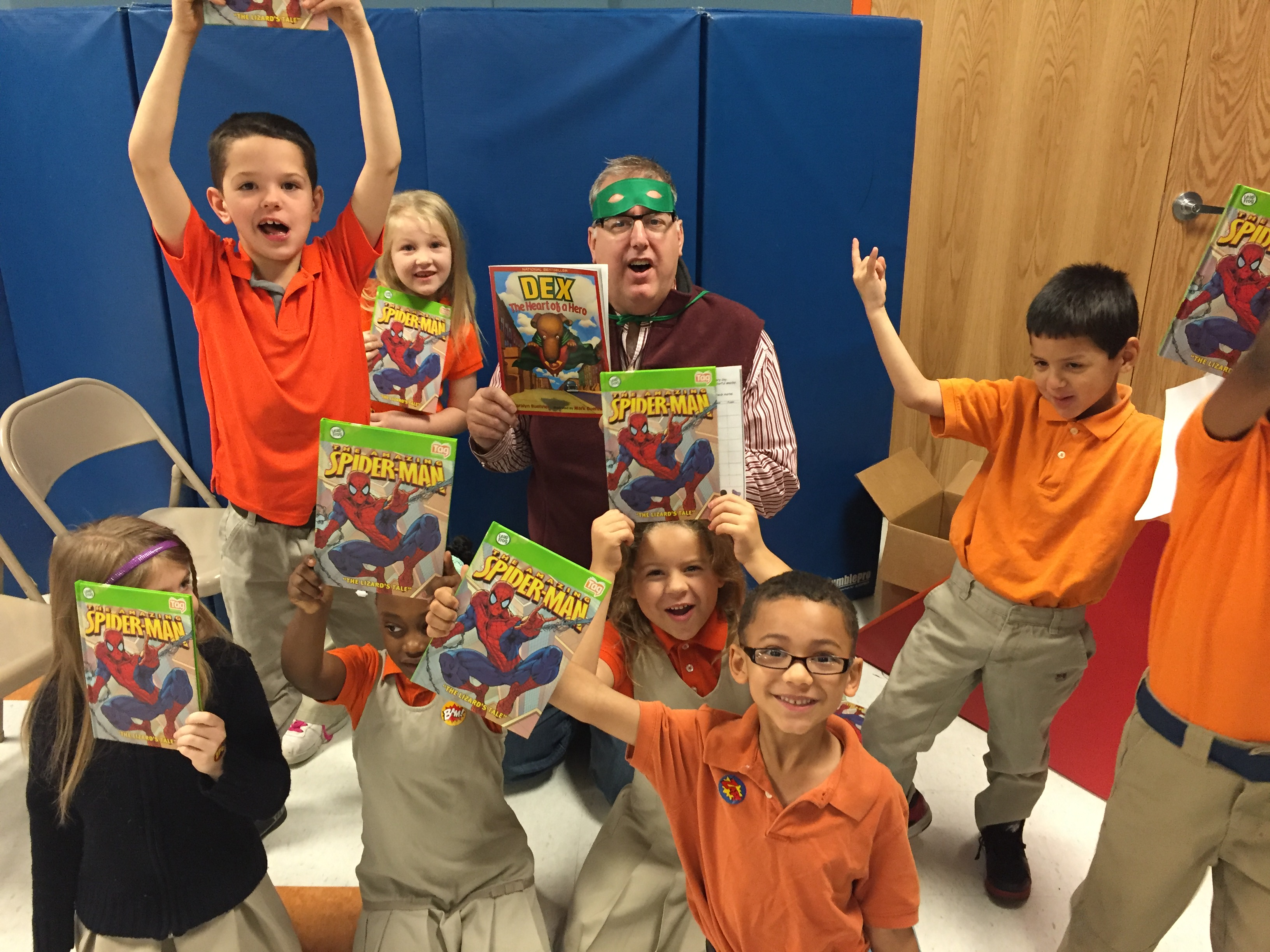 Excited kids showing their Spiderman commic books