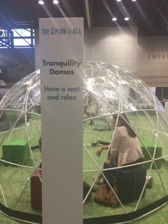 Person sitting within a Tranquility Dome