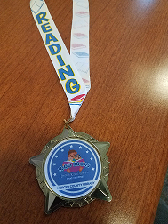 """gold medal wth multicolored """"reading"""" lanyard"""