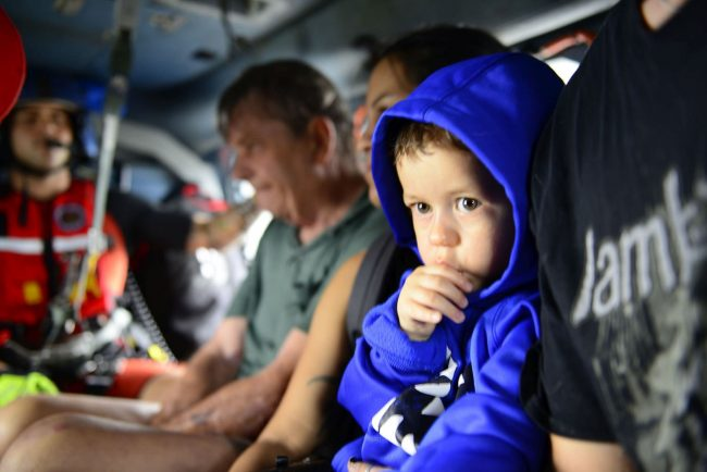 Photo of Child Being Transported to Safety by Coast Guard