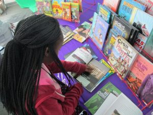A student examines new books on display
