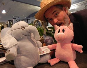 Mo Willems with Elephant & Piggie plush toys and a children's book card