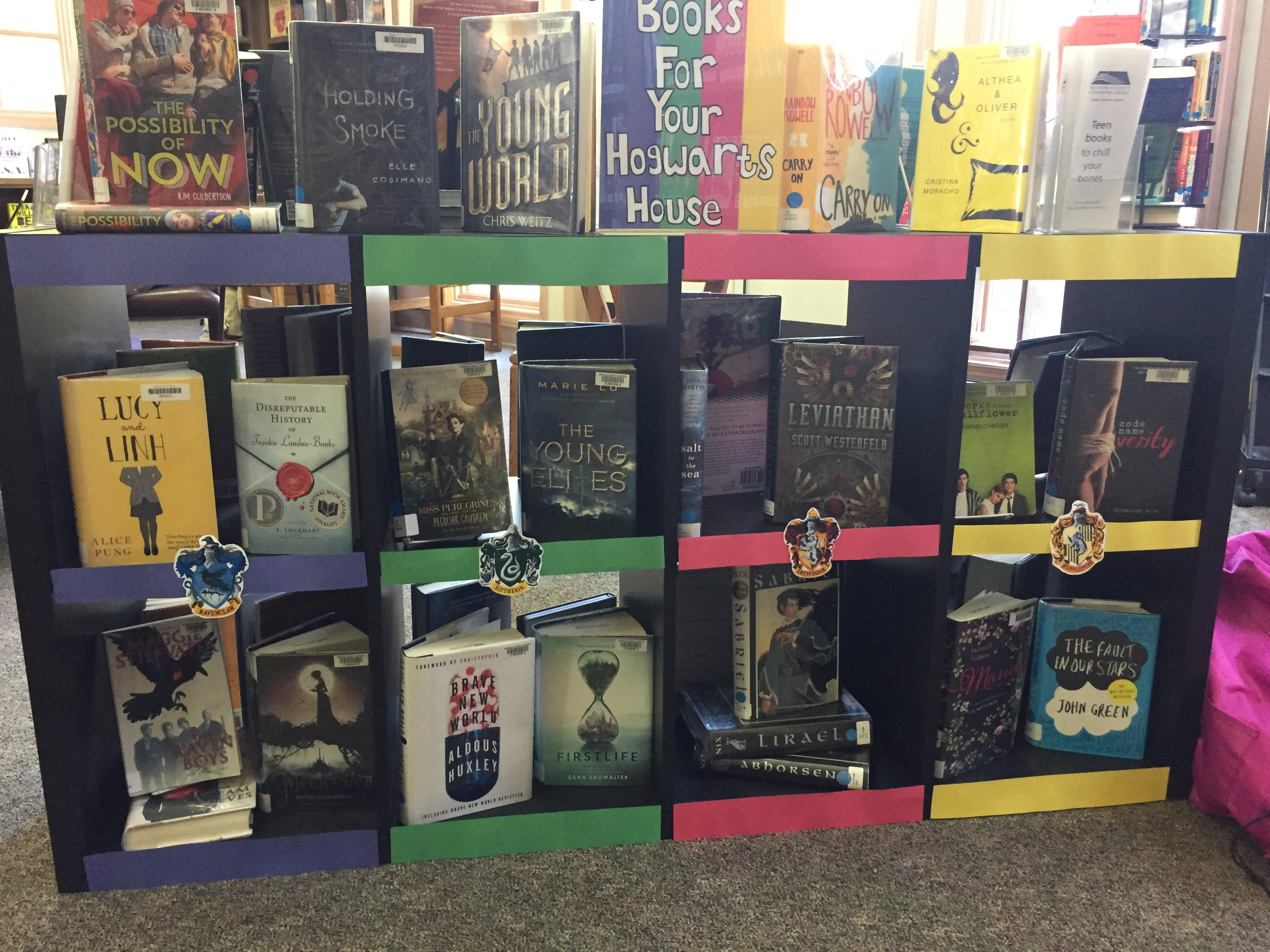 Display by Teen Intern of books sorted by Hogwarts houses
