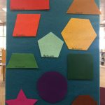 Colorful geometric shapes on a flannel wall
