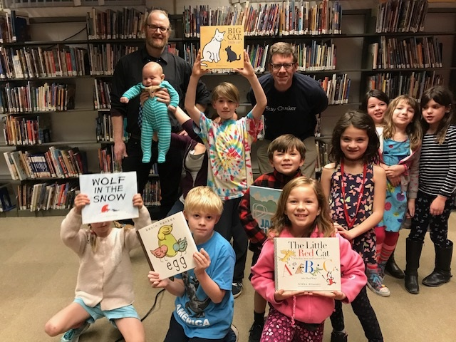 Caldecott Club kids holding their favorite books