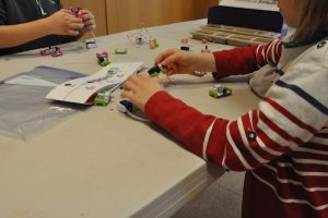 Two kids playing with LittleBits