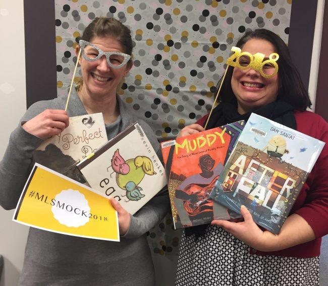 Two librarians celebrating the Mock Caldecott