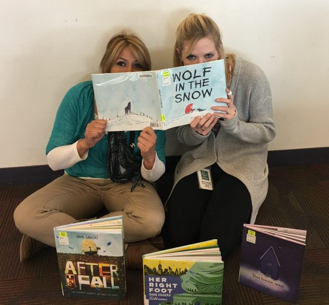 Two staffmembers read their Mock Caldecott winners