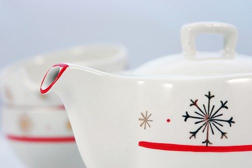 Teapot with snowflake painted on it.