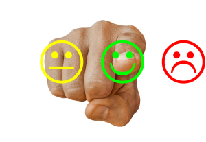 Index pointing at you signaling a happy, sad, or neutral face.