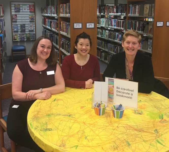 Nina Lindsay (right) visits with Bethany Hoglund (left) and Bernice Chang (center) at the Bellingham Public Library Children's Room