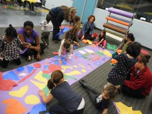 children participating in an art workshop at Athens Clarke County Library