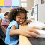 Child smiling and using technology