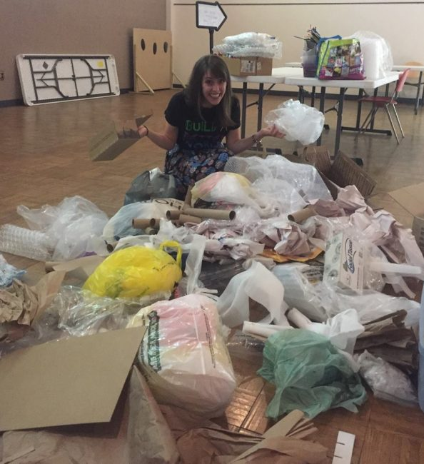 Blogger surrounded by Egg Drop Challenge materials