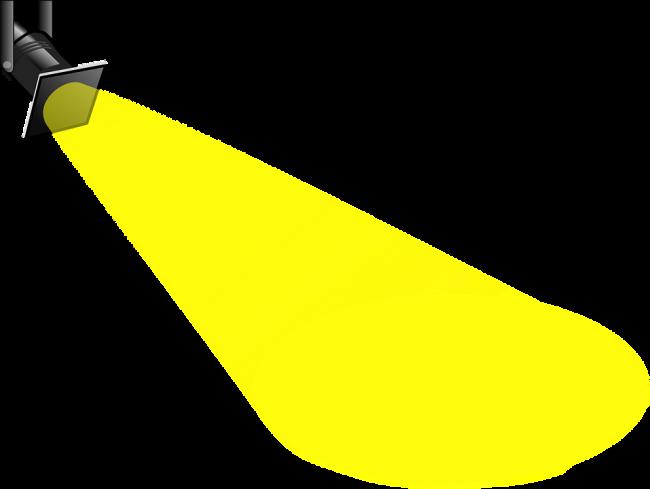 Spotlight search light shining a bright yellow beam