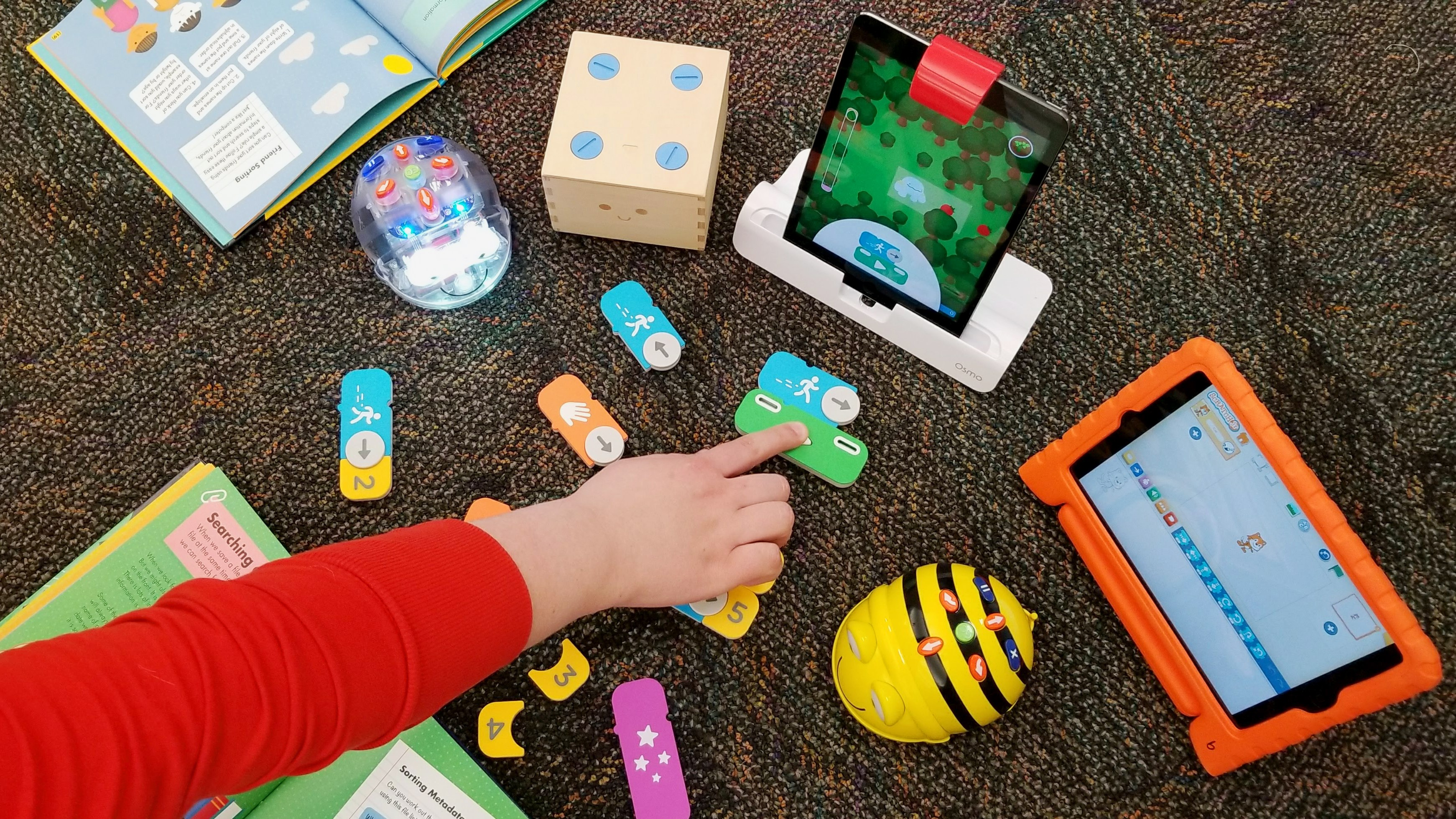 Bee Bots, Osmos, and iPads are a great introduction to early technology.