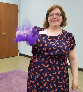 Me, demonstrating how a scarf turns into a butterfly. [Photo courtesy of the author.]