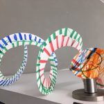 Color snakes made with paper plates, scissors, and markers