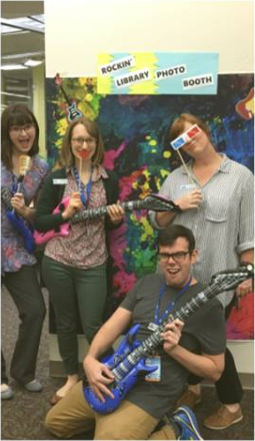 Belle Isle Library Staff take a picture with the Rockin' Library Photo Booth