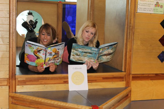 Two readers at the Gail Borden Public Library Mock Caldecott