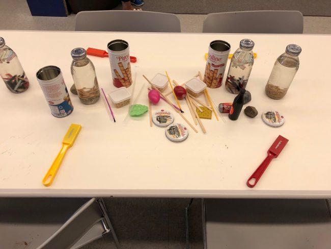 paint, sensory bottles, and magnet wands for magnet experimentation