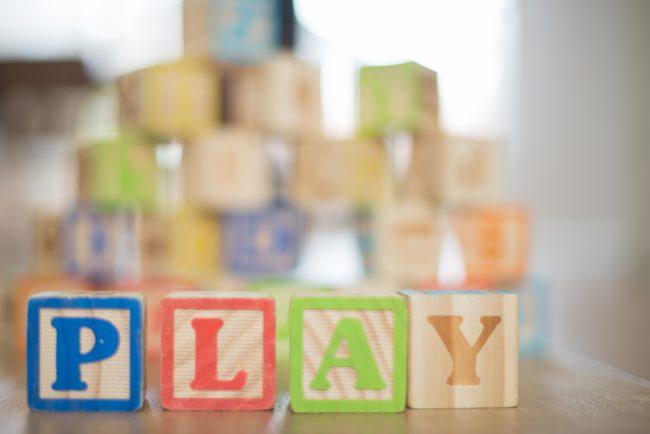 Alphabet blocks that spell play.